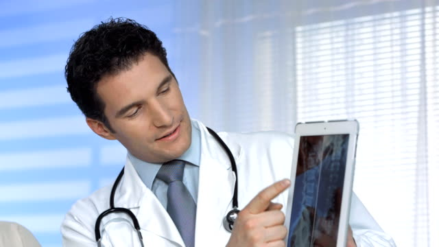 HD: Doctors Examining X-Ray Image On A Tablet