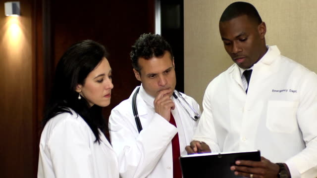 Doctors have Discussion Interacting with Digital Tablet - CU