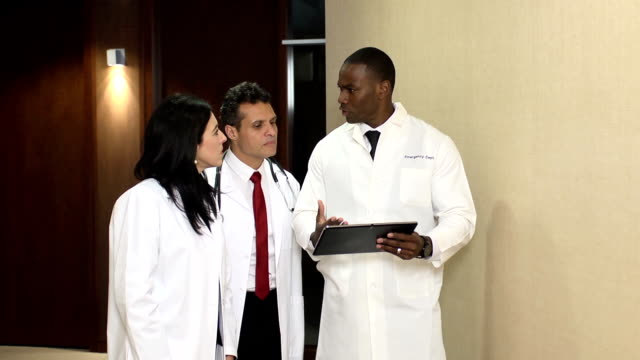 Doctors have Discussion Interacting with Digital Tablet - WS