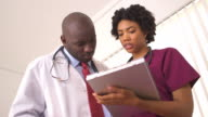 doctors reviewing medical charts