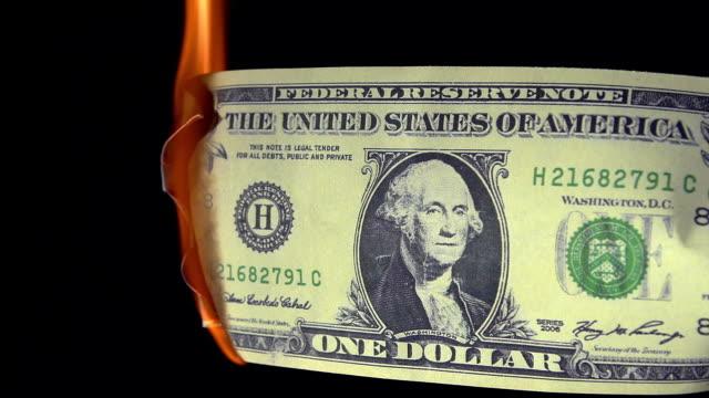 1 US Dollar Banknote Burning against Black Background, Real Time