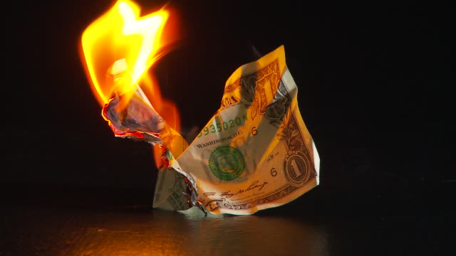 dollar bill burning