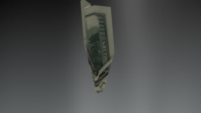 Dollar bill plane falls down concept - loopable