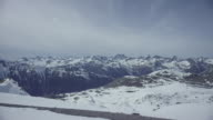 Dolly along beautiful mountain landscape.