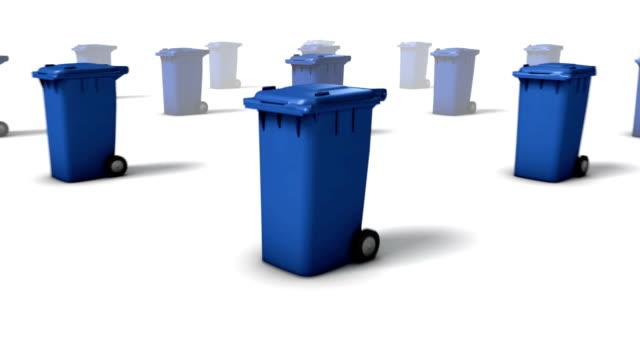 Dolly back diagonally from single Trashcan revealing many (Blue)
