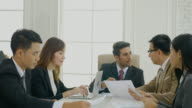 4K Dolly Businesswoman gives boss the documents to sign in meeting room