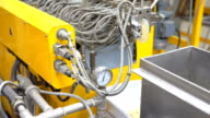 dolly: close-up to opening die on twin  screw extruder