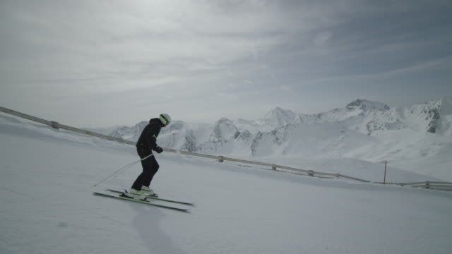 Dolly of skier skiing downhill.