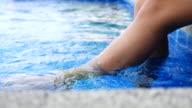 Dolly shot :Beautiful Woman Relaxing pool slde