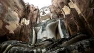 Dolly shot: Big buddha in Sukhothai historical park Thailand