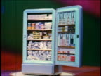 1955 dolly shot blue stand-up freezer filled with food