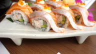 Dolly shot close up salmon sushi with avocado