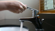 Dolly shot: Faucet opening and closing