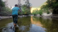 Dolly Shot: fisherman is fly fishing