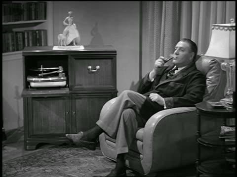 Bw 1950 dolly shot in man sitting in armchair smoking pipe for Sitting in armchair
