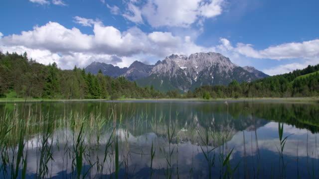 Dolly Shot. Lake Luttensee with Karwendel Mountain Range. Mittenwald, Garmisch-Partenkirchen, Luttensee, Karwendel, Werdenfelser Land, Upper Bavaria, Bavarian Alps, Bavaria, Germany, Europe.