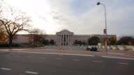 Dolly shot of a government building with pillars in Washington DC