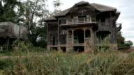 dolly shot of abandoned old house
