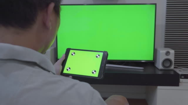Dolly shot of digital tablet and TV,Green screen