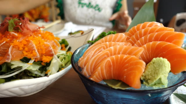 Dolly shot salmon sashimi and salmon salad
