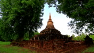 Dolly shot: Temple at Si Satchanalai historical park Sukhothai Thailand