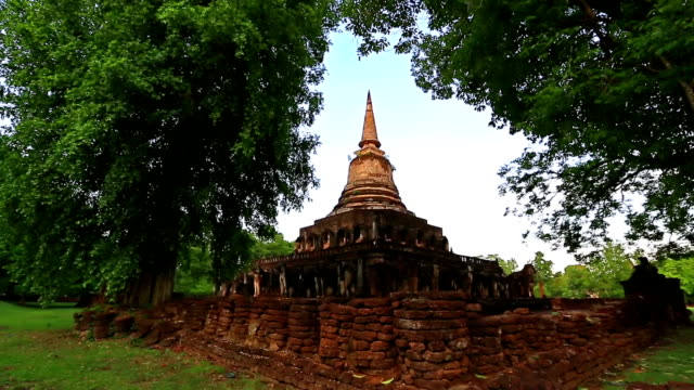 Dolly shot: Temple at Si Satchanalai historical park Sukhothai Thailand