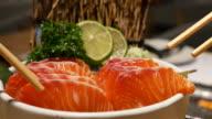 Dolly Shot:eating salmon sashimi