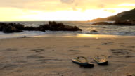 Dolly shot:Sandals at the sunset beach