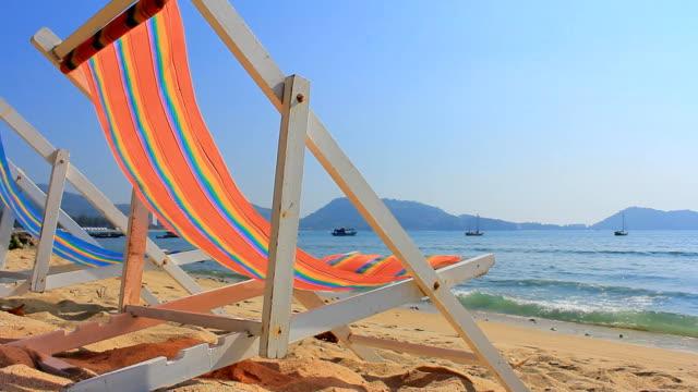 HD DOLLY:Sun chairs on sandy beach