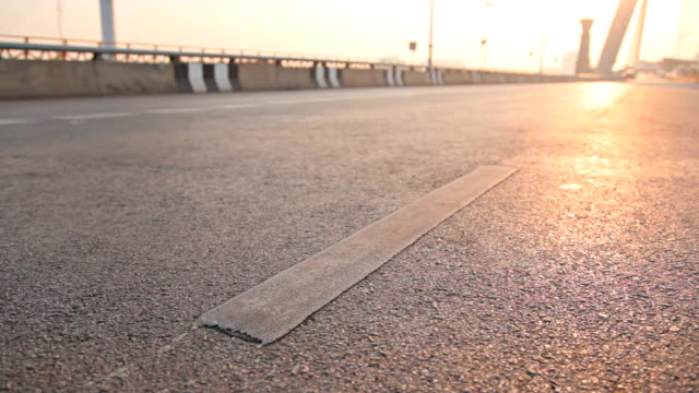 Dolly:symbol in road on bridge at morning.