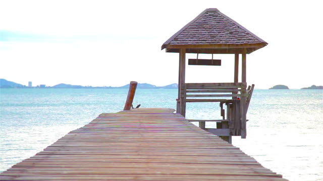 HD Dolly:Wooden pavilion and wooden bridge in the sea.