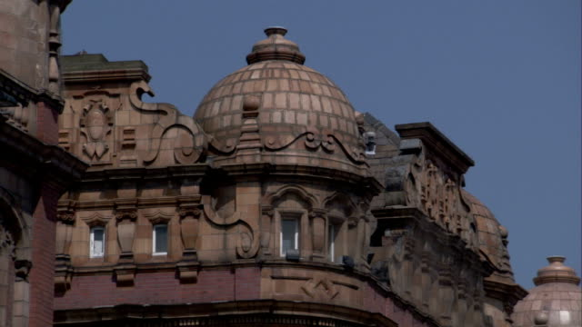 A dome tops the corner unit of a Victorian building in the Headingly district of Leeds. Available in HD.