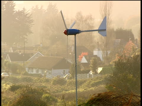 Domestic wind turbine stands motionless on calm day Cornwall