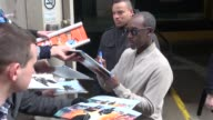Don Cheadle at AOL signs for fans on March 24 2016 in New York City