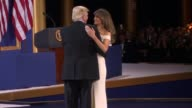 Donald and Melania Trump share their first dance at the Armed Services Ball