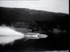Donald Campbell's fatal attempt ***ALSO ENGLAND Lake Coniston MS Bluebird sitting on Lake by jetty MS 'No8' on side Donald Campbell seen in cockpit...