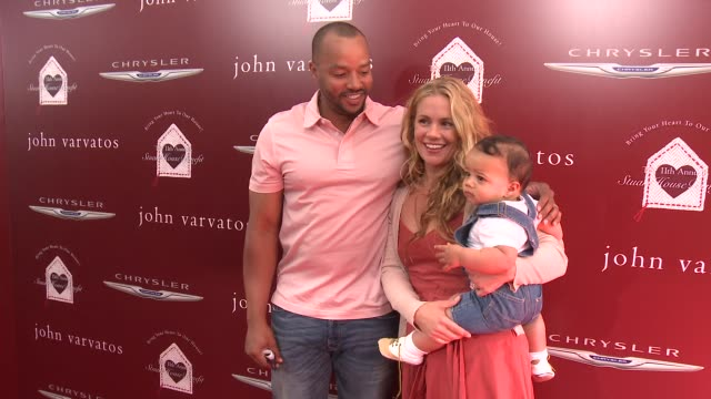 Donald Faison and CaCee Cobb at The John Varvatos 11th Annual Stuart House Benefit at John Varvatos on April 13 2014 in Los Angeles California