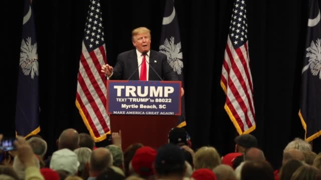 Donald Trump addresses a crowd during a campaign rally on the same day of the South Carolina Republican primary on February 19 2016 in Myrtle Beach...
