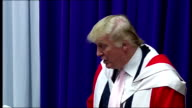 Donald Trump awarded Honorary Degree by Robert Gordon University in Aberdeen People in lecture hall clapping as Donald Trump shakes Dean's hand and...