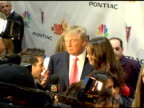 Donald trump interviewed by the media at the 'The Apprentice' Season Finale at LA Mart in Los Angeles California on June 5 2006