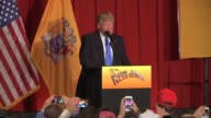 Donald Trump is introduced by Governor Chris Christie and family at a fundraiser at the Lawrenceville National Guard Armory that cost $200 per ticket...