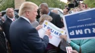 Donald Trump leaving event talking to people up close