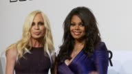 Donatella Versace Janet Jackson at the amfAR's Inaugural Milan Fashion Week Event at Milan