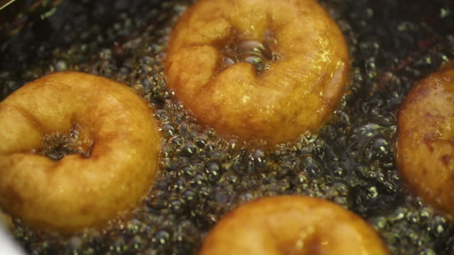 CU SLO MO donuts frying in oil/ Johannesburg/ South Africa