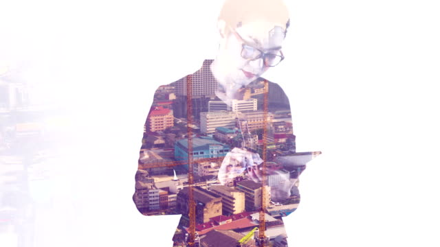 Double exposure businesswoman working with a digital tablet.