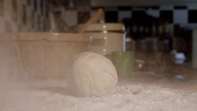 Dough Hitting Flour In Slow Motion