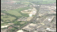 30 Airviews over the Channel Tunnel construction site goods train in station lorries along dirt track crane at enterance of tunnel village on edge of...