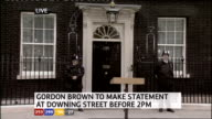 1330 1430 Downing Street EXT Front door of No10 with two police officers outside and podium in front