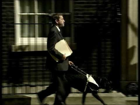 Home Secretary David Blunkett MP along with guide dog PAN to Number 10 Defence Minister Geoff Hoon MP along PAN to Number 10