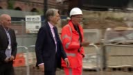 Downing Street refuses to comment on lifting public sector pay cap ENGLAND Manchester EXT Philip Hammond MP along with builders and interview SOT re...